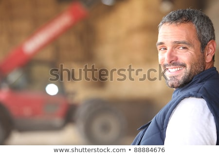Farmer stood in front of bails of hay Stock photo © photography33