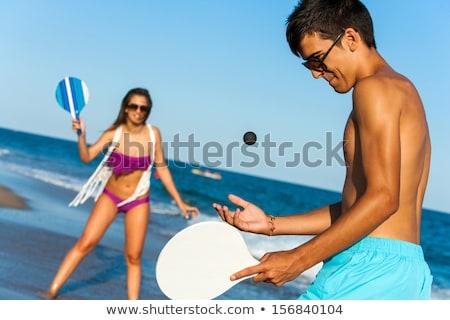 Сток-фото: пару · пляж · играет · женщину · лет · улыбаясь
