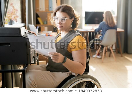Disabled female office worked with colleague Stock photo © photography33