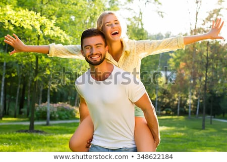 young couple playing around in the nature stock photo © hasloo