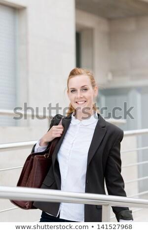 Jeune femme sac épaule regarder caméra Photo stock © stryjek