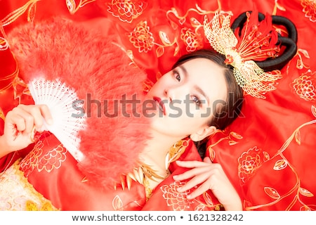 chinese woman in traditional white cheongsam stock photo © ronen