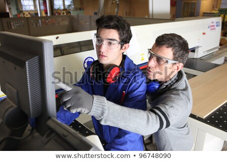 young craftsman pointing at earmuffs Stock photo © photography33