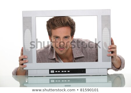 Young man smiling inside the frame of a TV set Stock photo © photography33
