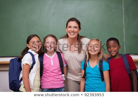 Foto stock: Teacher With Her Student Posing