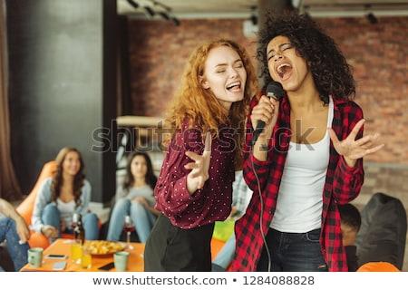 vonzó · nő · sikít · mikrofon · énekel · fekete · nő - stock fotó © keeweeboy