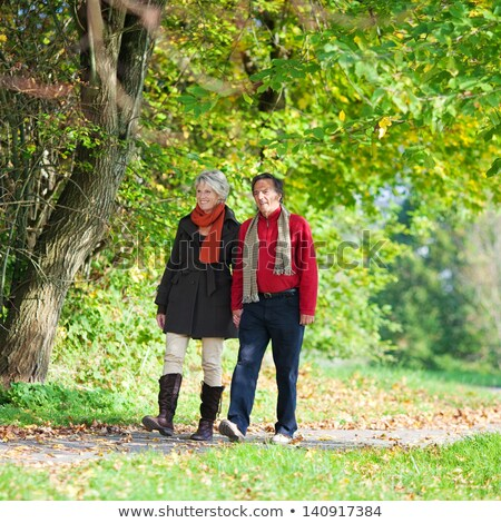 Older couple enjoying an autumnal stroll Stock photo © photography33
