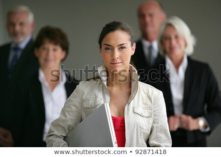 An intern posing with her superiors Stock photo © photography33