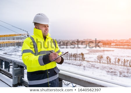 Foto stock: Architect Man Make Notes On Construction Site