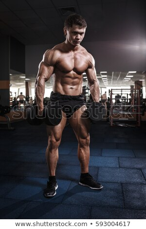 Stock fotó: Egészalakos · izmos · férfi · testmozgás · súlyzó · fehér