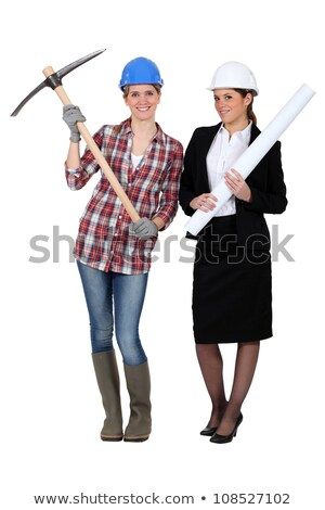 Woman construction worker standing with a pickaxe Stock photo © photography33