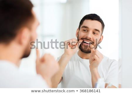 Adam dişler ayna iyi oral temizlik Stok fotoğraf © lisafx