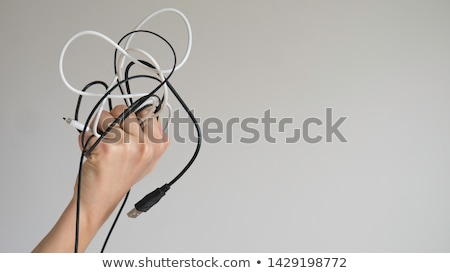 Hand holding grey USB cable  stock photo © Taigi