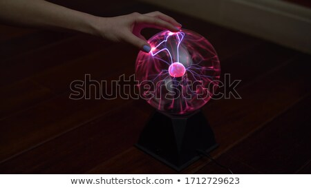 Stock photo: Hand touching a bright ball