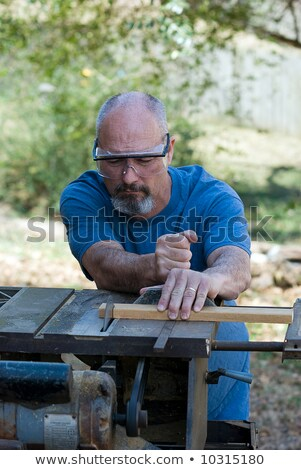 Determined tradesman using a power tool Stock photo © photography33