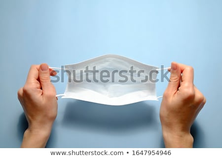 Woman holding face mask Stock photo © photography33