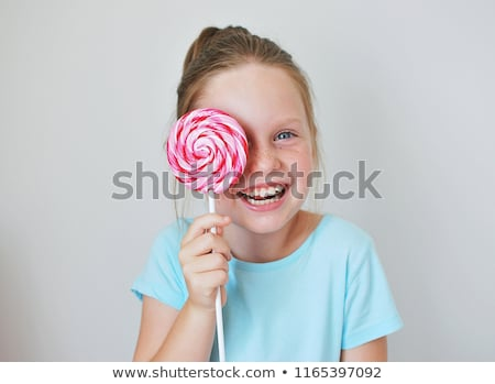 little girl with lollipop candy stock photo © Marcogovel