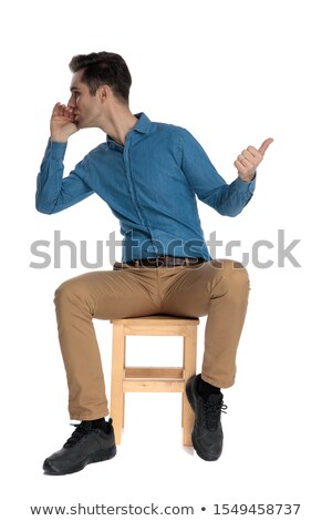 man sitting, pointing and speaking stock photo © feedough