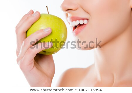 Woman biting into green apple Stock photo © photography33