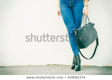 Meisje zwarte strak jeans handtas geïsoleerd Stockfoto © acidgrey