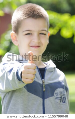 smiling kinder garden boy gives thumbs up stock photo © get4net