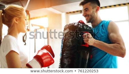 beautiful blonde woman wearing boxing gloves stock photo © dash