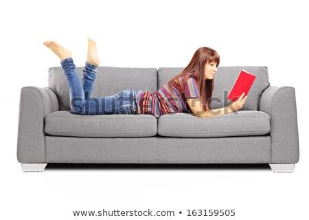 Cute jeune femme canapé lecture livre fille Photo stock © ErickN