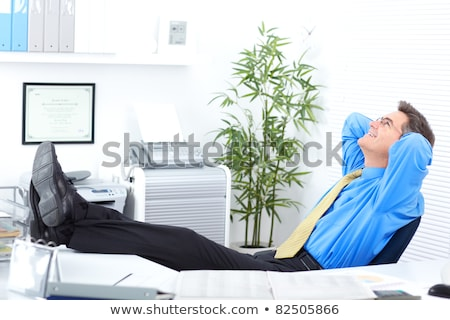 portrait of smiling relaxed business man in blue shirt stock photo © scheriton