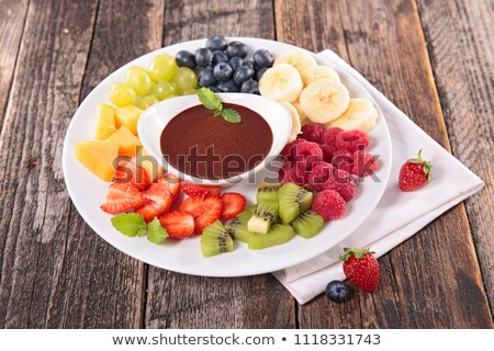 chocolate sauce and assorted of fruits Stock photo © M-studio