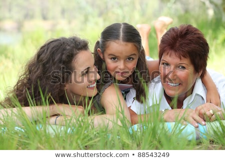 Grandmother, mother and daughter lying in the grass Stock photo © photography33