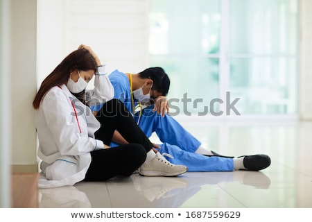 stressed nurse medical professional with headache stock photo © maridav