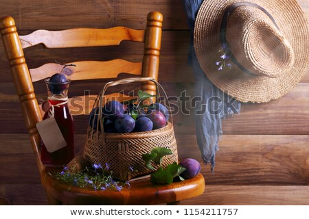 plums in a wicker basket Stock photo © martin33