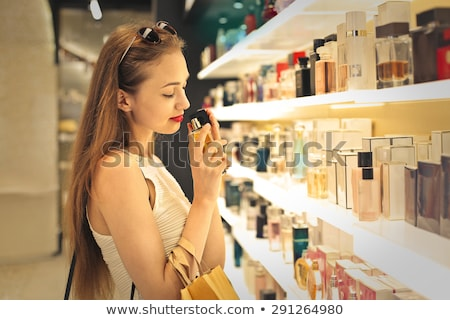 Foto stock: Woman Buying Perfume In Shop Or Store
