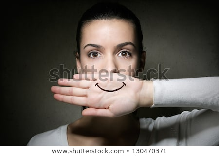 young girl crying with her hand covering her mouth stock photo © nenetus