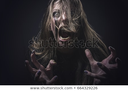 Evil Angry Woman With Crazy Hair Stock photo © tobkatrina