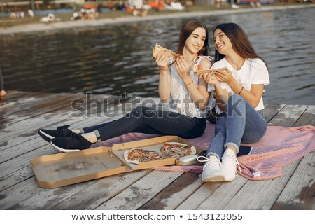 Portrait of two beautiful girls near the river Stock photo © Nejron