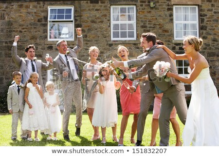 bride and groom opening champagne in front of guests stock photo © monkey_business