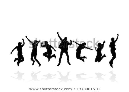 jumping and enjoying silhouettes  stock photo © Slobelix