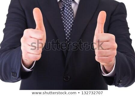 Gelukkig zakenman tonen overwinning teken Stockfoto © feedough