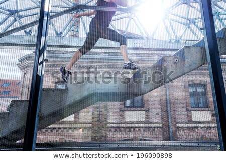 Running woman in black sports outfit, running up the stairs ,detail photo Stock photo © Geribody