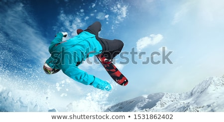 Extreme Snowboarder jumping Stock photo © smuki
