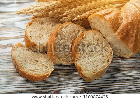 long loaf with ears of wheat  Stock photo © OleksandrO