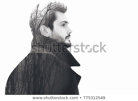 black and white photo of a pensive fashion man looking away stock photo © deandrobot