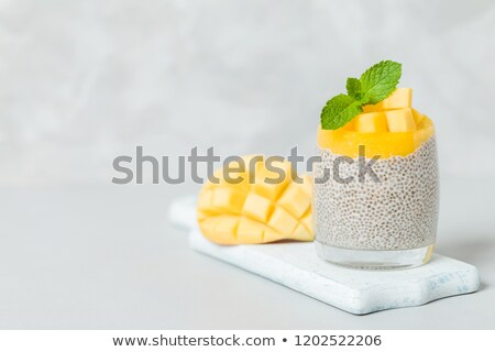 Zaad mango pudding gezonde kom hout Stockfoto © ildi