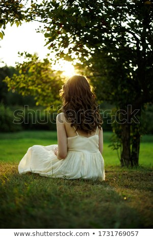 Stock photo: view of a young woman in the sun
