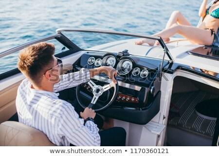 alegre · mulher · condução · veleiro · sorrindo - foto stock © Anna_Om