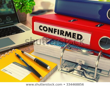 Red Office Folder with Inscription Confirmed. Stock photo © tashatuvango