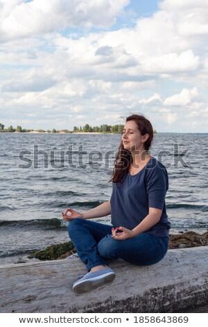 young woman sits ashore of sea Stock photo © Paha_L