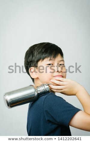 Tween Boy in Smiling Over Shoulder at Camera Stock photo © ozgur