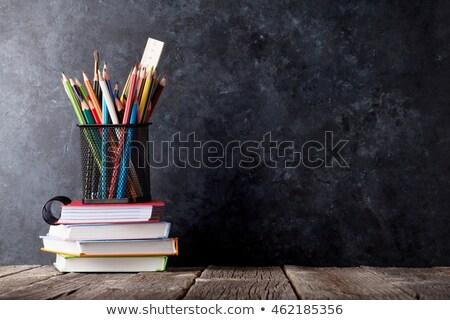 Books in front of chalk board Stock photo © karandaev